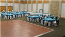 Turquoise and white wedding reception with table settings of turquoise table cloths and dance floor in the middle